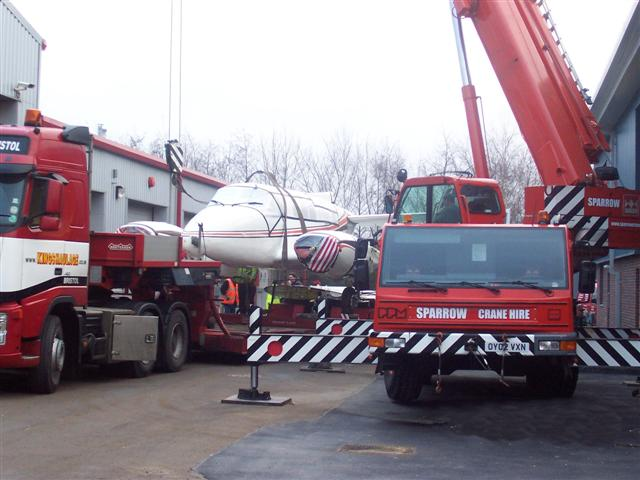 aircraft craned onto truck